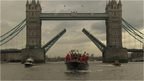 Boat passes under Tower Bridge