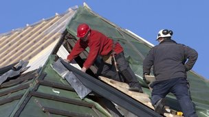 Builders on a roof