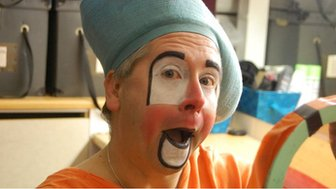 Andy the Clown puts on his make-up