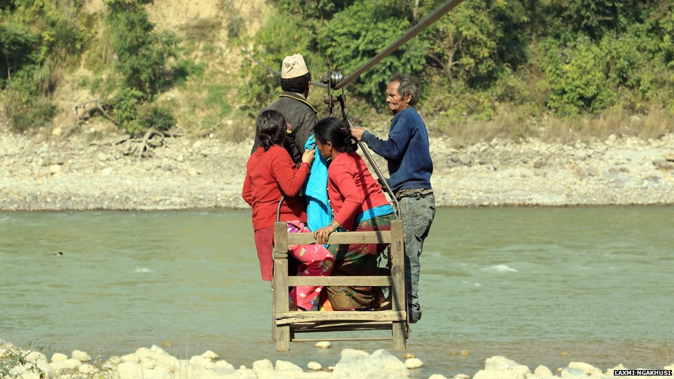 Villagers using a wire bridge in Charaudi
