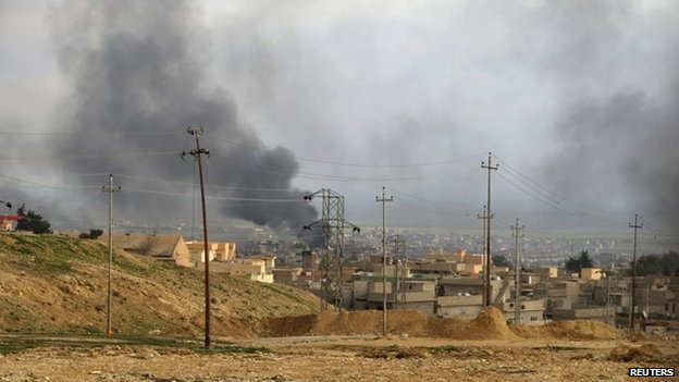 A general view shows the town of Sinjar as smoke rises from what activists said were U.S.-led air strikes December 22, 2014