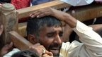 Mourner carrying the coffin of a blast victim during the funeral ceremony in Shikarpur (31 January 2015)