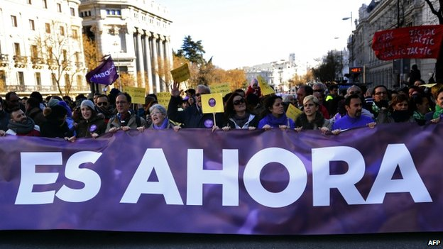 "Banner at Podemos rally reads ""is now"" - 31 January"