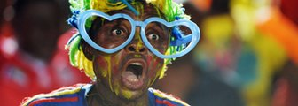 A DR Congo fan cheers for his team