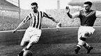 Sir Stanley Matthews beating a defender