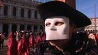 Masked man at Carnival in Venice