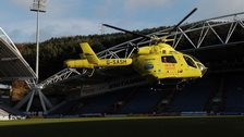 A helicopter takes Huddersfield's Tommy Smith to hospital