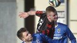 Dungannon goal-scorer Ryan Harpur battles with Crusaders striker Jordan Owens