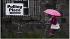 A voter arrives to cast her ballot at the Queen's Cross parish church in Aberdeen, Scotland