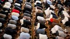 Men praying in East London Mosque