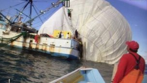 Handout image released by the Two Eagles Balloon Team showing the capsule envelope being recovered by a Mexican fishing boat