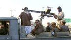 Shia-Muslim Houthis with large gun mounted on back of a truck in the Yemeni capital, Sanaa