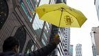 A pro-democracy protester holds up a yellow umbrella during Sunday's march (01 February 2015)