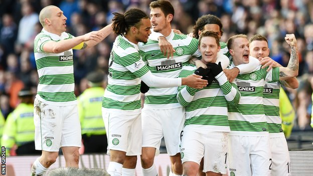 Celtic celebrate after taking a 2-0 lead through Kris Commons