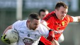 Down's Brendan McArdle battles with Kildare's Daryl O'Brien