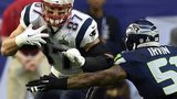 New England Patriots tight end Rob Gronkowski runs against Seattle Seahawks outside linebacker Bruce Irvin