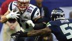 New England Patriots tight end Rob Gronkowski runs against Seattle Seahawks outside linebacker Bruce Irvin
