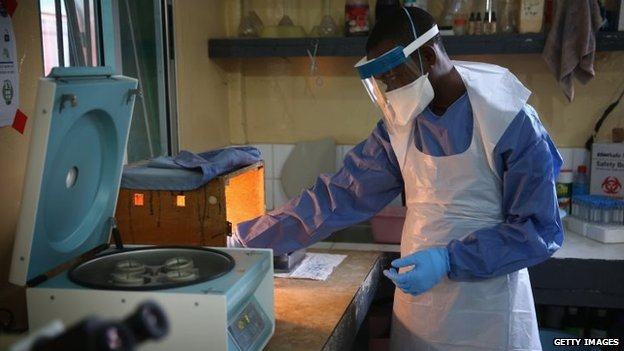 A health worker wearing protective clothing waits in Redemption Hospital on 1 February 2015 in Monrovia, Liberia.