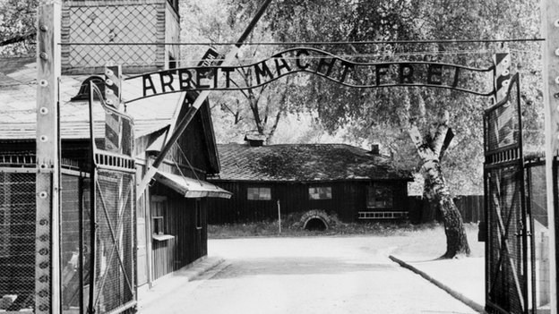 "The notorious Auschwitz camp gate, with the inscription ""Arbeit Macht Frei"" (""work makes you free"")"