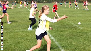 girls practising rounders skills