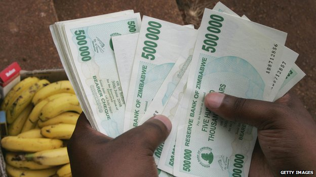 Man holding Zimbabwean dollars back in 2008