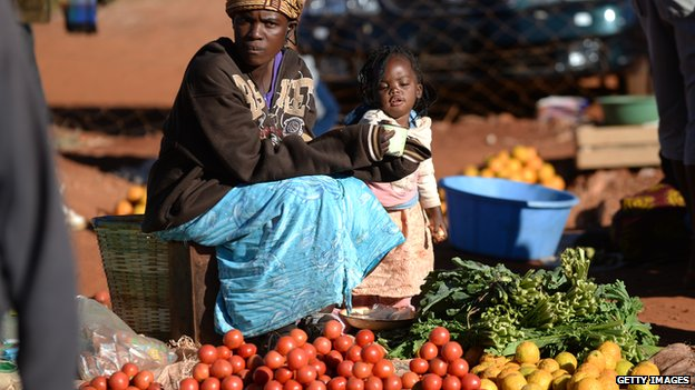 A woman selling fruit and vegetables in the Zimbabwean town of Domboshava