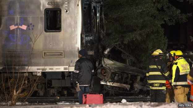 A car crushed by the front of a commuter train