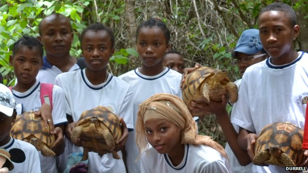 Children in Madagascar with ploughshare tortoises about to be released