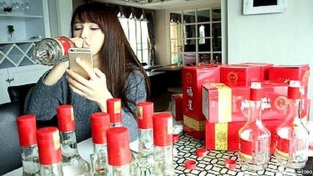 Chinese woman drinking baijiu