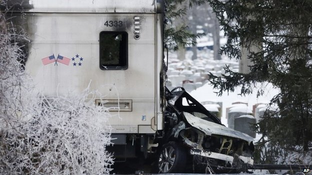 A sports utility vehicle remains crushed and burned at the front of a Metro North train Vahalla, New York 5 February 2015