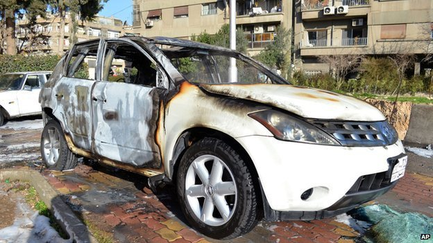 Cars damaged by mortar fire which hit the central Damascus district of Baramkeh on Thursday