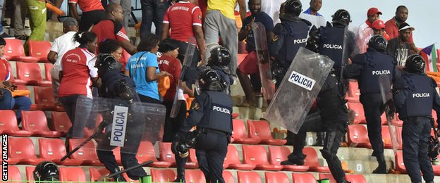 Riot police close in on fans