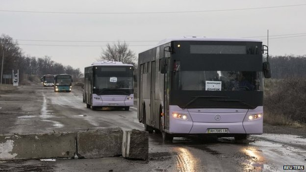 "Empty buses head to Debaltseve in eastern to Ukraine on Friday to evacuate civilians caught in fighting between Ukrainian forces and pro-Russian rebels. Signs on the windscreen window read: ""Evacuation to Donetsk"""