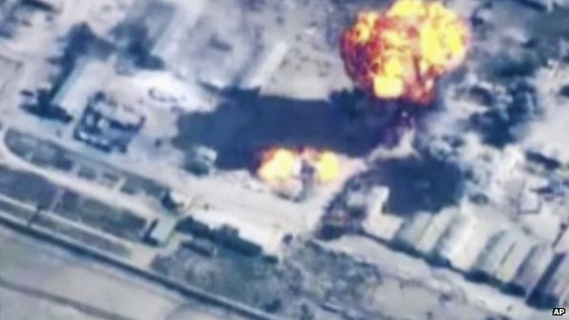 In this image made from undated video provided by Jordanian military via Jordan TV, explosions go off as the military carried out airstrikes at an undisclosed location in Syria.