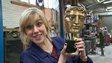 Jenny holding a Bafta award