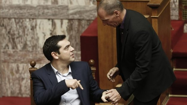 Alexis Tsipras (seated) and Yanis Varoufakis,
