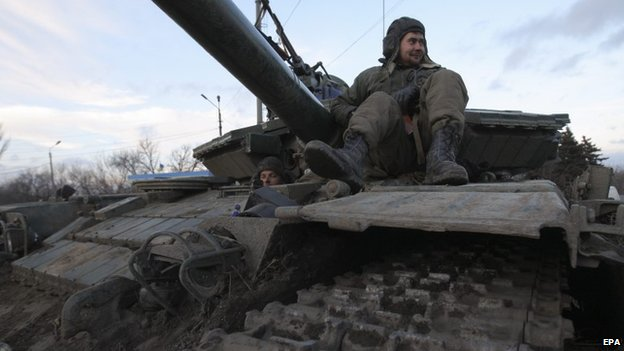 Ukrainian servicemen rest on a tank in Artyomovsk of Donetsk area, Ukraine, 08 February 2015