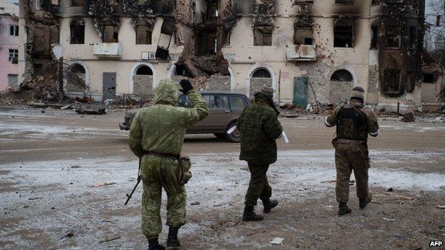 Pro-Russian rebels walk on February 7, 2015 in the eastern Ukrainian town of Vuhlehirsk in the Donetsk region.