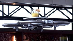Drone waiter carries drink