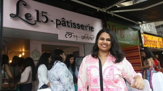 Pooja Dhingra in front of one of her three shops