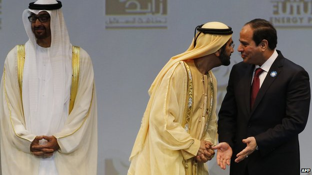 President Abdel Fattah al-Sisi speaks to Dubai's ruler, Sheikh Mohammad bin Rashed al-Maktoum at the opening of the World Future Energy Summit in Dubai