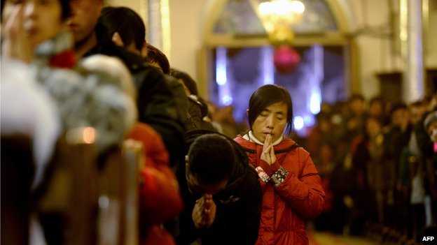 Chinese Catholics attend church