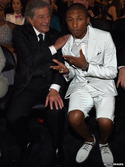 Pharrell Williams sits next to Tony Bennett.