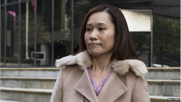 Law Wan-tung, former employer of Indonesian domestic helper Erwiana Sulistyaningsih, leaves the district court in Hong Kong 8 January 2015