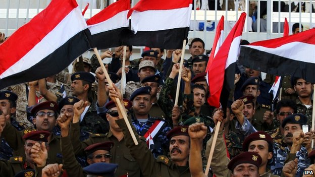 Yemeni army officers loyal to the Shiite Houthi Group shout slogans and wave Yemeni flags during a celebration on a new constitutional declaration announced one day ago by the Group in Sana'a, Yemen, 07 February 2015