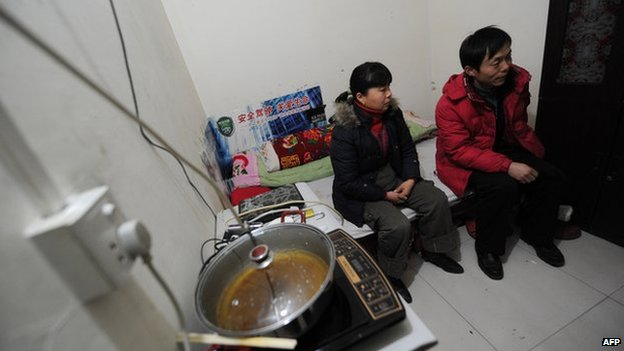 Two residents inside their underground apartment inside an old civil defence shelter