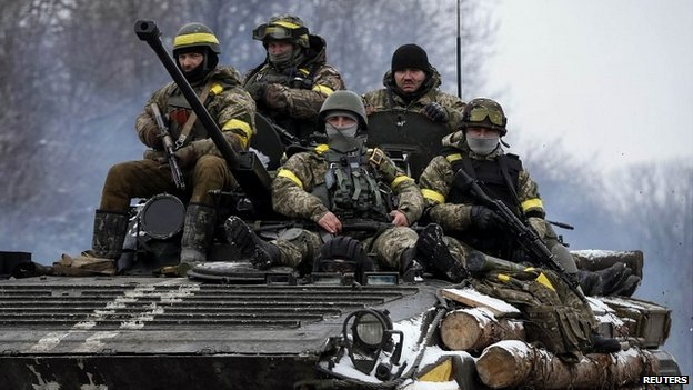 Members of the Ukrainian armed forces ride on an armoured personnel carrier near Debaltseve in eastern Ukraine - 10 February 2015