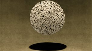 A bouncing rubber band ball
