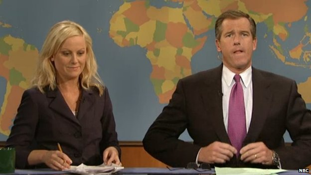 Amy Poehler and Brian Williams prepare for skit on Saturday Night Live's Weekend Update