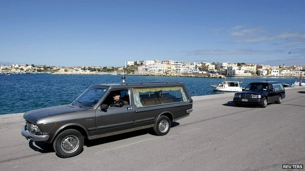 Hearses transport the remains of migrants who died at sea at the Lampedusa harbour - 11 February 2015